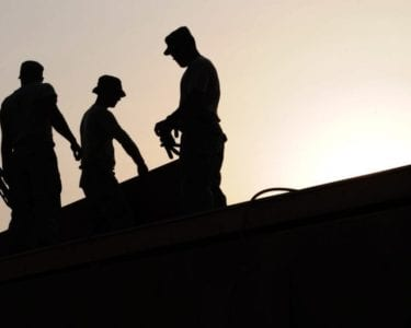 Construction Workers Roofing Sunset