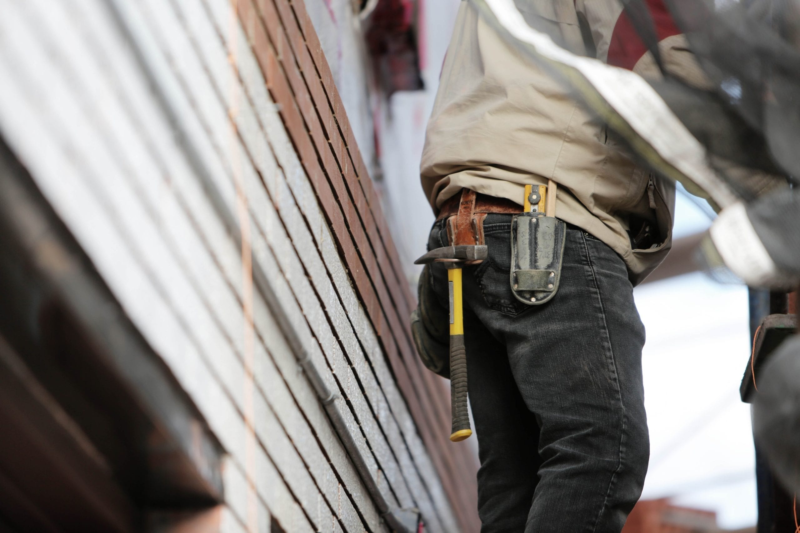 construction worker with a hammer in his belt